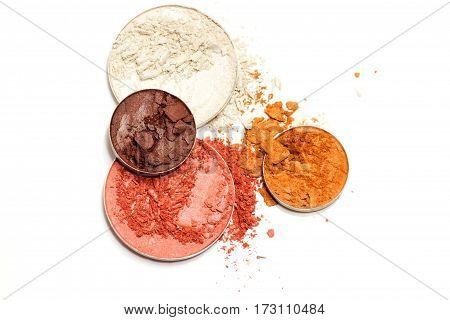Pink and white blusher or brown and gold eyeshadow isolated on white background