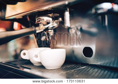 Professional Coffee Brewing. Espresso Machine Preparing And Pouring Two Perfect Cups Of Coffee. Rest