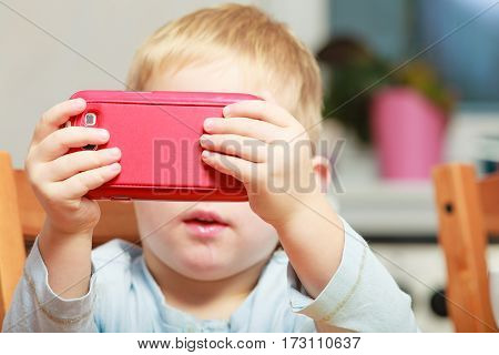 Little Boy Using Smartphone Playing Games