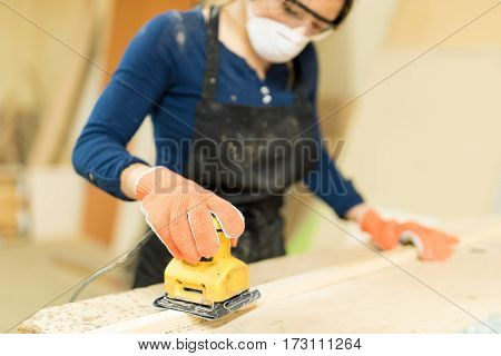 Woman Working In A Woodshop