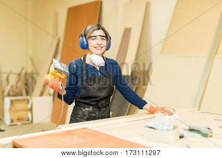 Pretty Hispanic Female Carpenter