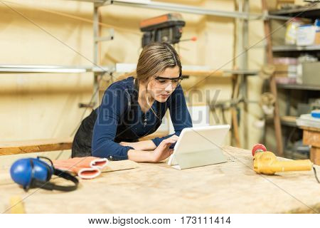 Cute Carpenter Using A Tablet Computer