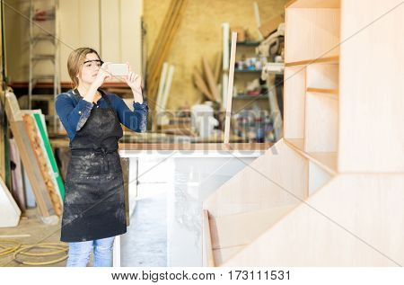 Woman Taking Photo Of Finished Product