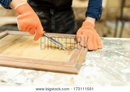 Carpenter Using A Wood Gouge
