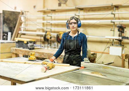 Attractive Female Carpenter At Work