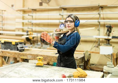 Young Woman Working In A Woodshop