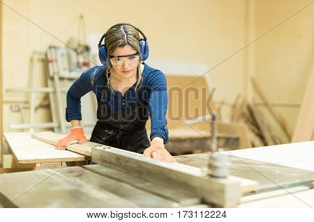 Female Carpenter Using A Table Saw