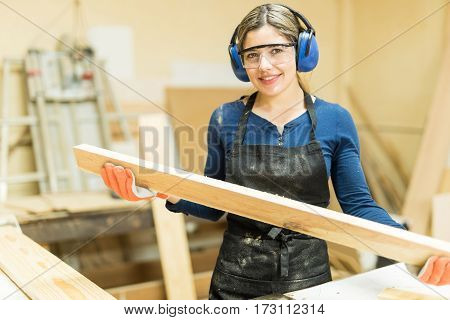 Young Woman Working As A Carpenter