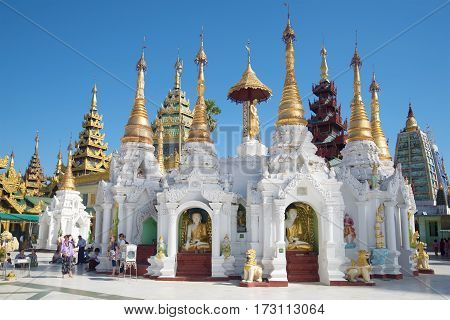 YANGON, MYANMAR - DECEMBER 17, 2016: One of the temples of the Shwedagon pagoda on a sunny day