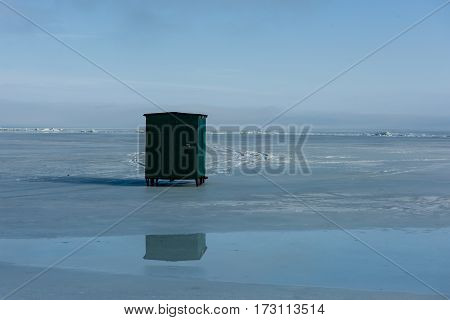Ice shanty on a frozen lake to keep warm while fishing during the winter.