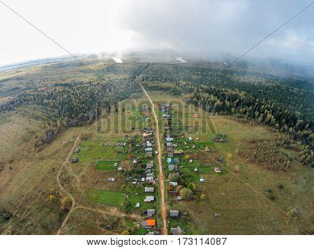 Village in the backwoods of Russia. The view from the top. The village of Khabary one street.