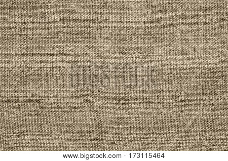 Homespun hemp cloth. Close-up of texture fabric cloth textile background. Homespun hemp fabric material. Homespun hemp canvas. Natural authentic cloth. Beige colour.
