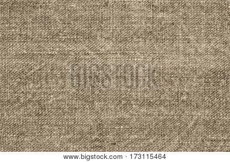 Homespun hemp cloth. Close-up of texture fabric cloth textile background. Homespun hemp fabric material. Homespun hemp canvas. Natural authentic cloth. Beige colour.