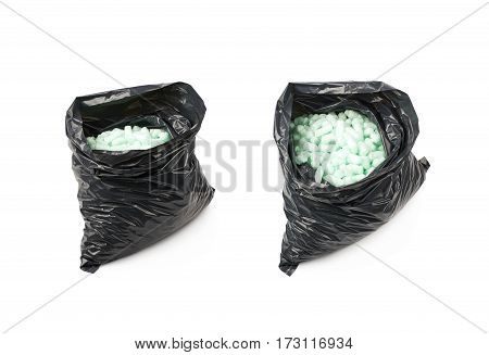 Black plastic bag full of bioplastic packing foam peanuts isolated over the white background, set of two different foreshortenings