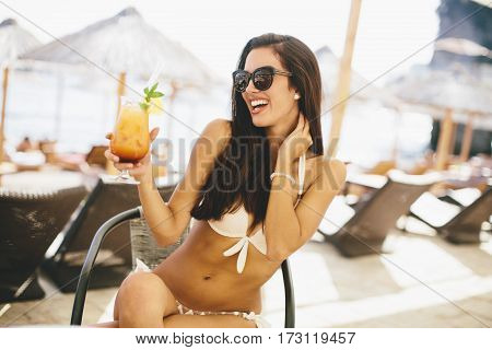 Young Woman With Coctail On The Beach At Summer