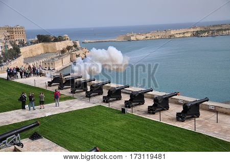The view from the Upper Barrakka Gardens in Malta, with the cannon firing