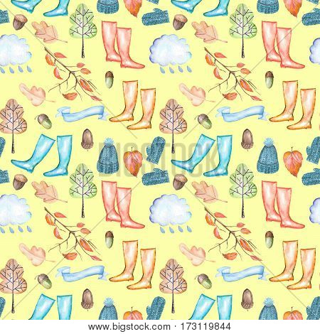 Seamless pattern with watercolor autumn objects (warm hat and mittens, rubber boots, rain cloud, dry tree leaves and other), hand drawn isolated on a yellow background