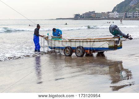 KAMAKURA, JAPAN - NOVEMBER 10, 2016: Fisherman boat on the Pacific beach of Kamakura, Japan. Kamakura is a city in Kanagawa Prefecture, about 50 kilometres south-west of Tokyo.