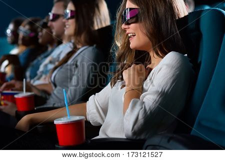 That was hilarious Shot of a beautiful woman wearing 3D glasses laughing while watching a movie
