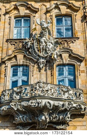BAMBERG, GERMANY - Circa September, 2016: Ornate historic Baroque carved stone balcony on the exterior facade of an old building in Bamberg, Germany listed as a World Heritage Site by UNESCO