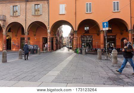 BOLOGNA ITALY -FEBRUARY 08 2017:old street with arches of Archiginnasio palace University of Bologna via Zamboni