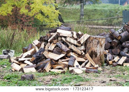 Cut logs fire wood. Renewable resource of energy. Environmental concept. Pile of chopped fire wood prepared for winter ready for burning