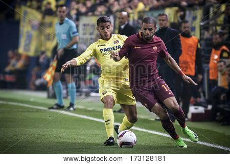 VILLARREAL, SPAIN - FEBRUARY 16: (L) Dos Santos, (R) Peres during UEFA Europa League match between Villarreal CF and AS Roma at Ceramica Stadium on February 16, 2017 in Villarreal, Spain