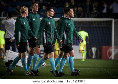 VILLARREAL, SPAIN - FEBRUARY 16: Referee team during UEFA Europa League match between Villarreal CF and AS Roma at Ceramica Stadium on February 16, 2017 in Villarreal, Spain