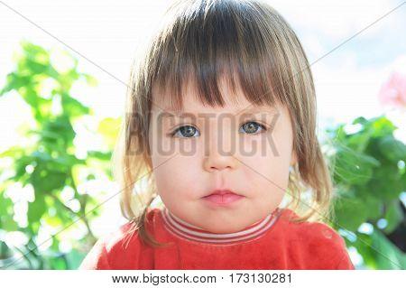 Child portrait with neutral facecaucasian little gril unemotional face
