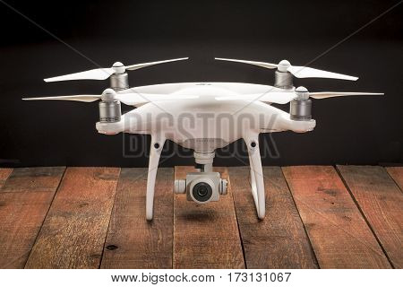 FORT COLLINS, CO, USA - FEBRUARY 23, 2017:  DJI Phantom 4 pro quadcopter drone with a camera  on a rustic wooden table.