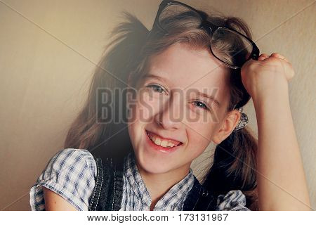 Little Kid Girl Looking Happy Wearing Glasses. Vintage Portrait