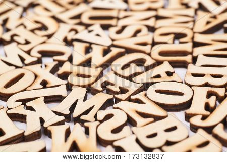 Surface covered with the multiple wooden letters as a creative education backdrop composition