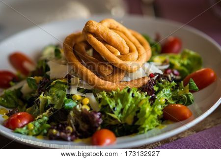 Salad Of Green Leaves, Cherry Tomatoes And Bread Spirals