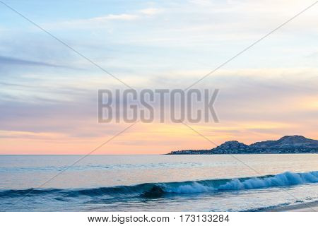 Set of pictures of a fantastic ocean wave in different stages. Cloudy sunrise sky. San Jose del Cabo. Mexico.