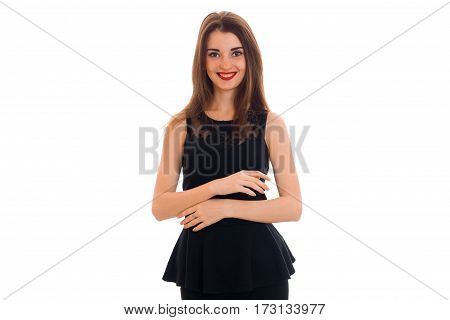 portrait of cheerful young brunette woman in stylish black dress posing and looking at the camera isolated on white