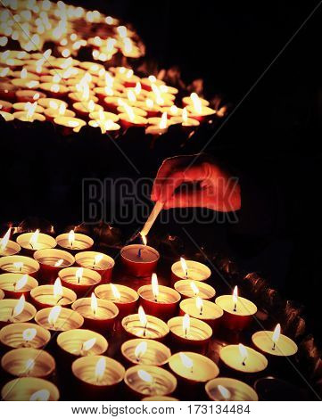 Hands Of An Elderly Woman Who Lights A Candle During The Holy Ma