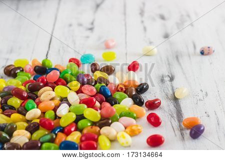 Candy Jelly Beans On Bright Wooden Background