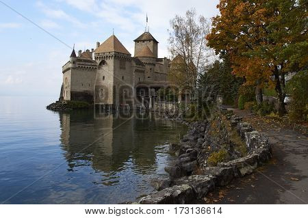 CHILLON CASTLE, SWITZERLAND - NOVEMBER 06, 2014: View of Chillon Castle, one of the most visited castles in Switzerland and Europe, from the promenade with a special place to make photos.