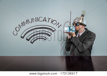 Communication text with vintage businessman kissing machine