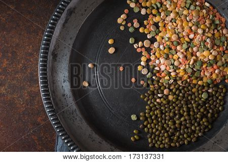 Placer lentils on a pewter plate on the table horizontal