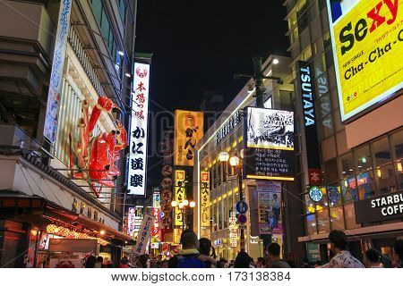 OSAKA JAPAN - AUGUST 1 2015 : Nightlife at Dotonbori Canal in Namba district of Osaka Japan the famous entertainment area which many restaurants bars and shops around here.