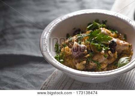 Pilaf with rice, chicken, garlic and parsley horizontal