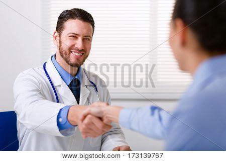 Doctor In White Coat Shake Hand