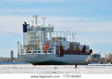 14.02.2017.Russia.Saint-Petersburg.A tanker loaded with containers leaves a port in the sea.