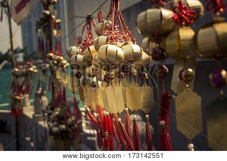 Chinese wishes amulets hanging on the wall in the buddhist temple of Wong Tai Sin in Hong Kong.