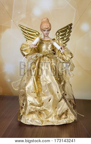 A golden angel tree topper for the Christmas holiday