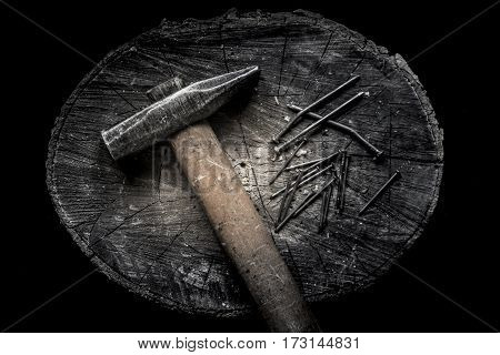 654677 Hammer With Wooden Handle With Many Iron Hobnails On The Wooden Stub. Brutal Male Style