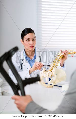 Orthopaedic Surgeon Explaining A Back Injury