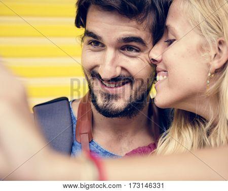 Couple taking a sweet mobile selfie