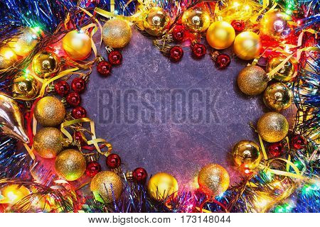 Frame of Christmas toys on table. Celebrate the New Year. Flat lay top view copyspace. Garlands